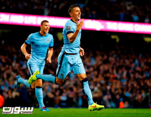 "Manchester City's Stevan Jovetic (front) celebrates after scoring a goal against Liverpool during their English Premier League soccer match at the Etihad stadium in Manchester, northern England August 25, 2014.  REUTERS/Darren Staples  (BRITAIN - Tags: SPORT SOCCER) FOR EDITORIAL USE ONLY. NOT FOR SALE FOR MARKETING OR ADVERTISING CAMPAIGNS. NO USE WITH UNAUTHORIZED AUDIO, VIDEO, DATA, FIXTURE LISTS, CLUB/LEAGUE LOGOS OR ""LIVE"" SERVICES. ONLINE IN-MATCH USE LIMITED TO 45 IMAGES, NO VIDEO EMULATION. NO USE IN BETTING, GAMES OR SINGLE CLUB/LEAGUE/PLAYER PUBLICATIONS"