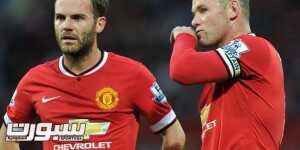 12 August 2014 Friendly Football Match - Manchester United v Valencia  Wayne Rooney & Juan Mata stand over the ball at a United free kick. Photo: Steve Parkin