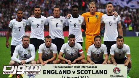 The England starting XI, (top L-R) midfielder Theo Walcott, defender Kyle Walker, defender Phil Jagielka, striker Danny Welbeck, goalkeeper Joe Hart, defender Gary Cahill, (bottom L-R) striker Wayne Rooney, midfielder Tom Cleverley, captain Steven Gerrard, defender Leighton Baines and midfielder Jack Wilshere pose for a team picture before kick off of the international friendly football match between England and Scotland at Wembley Stadium in London on August 14, 2013. England won 3-2. AFP PHOTO / CARL COURT NOT FOR MARKETING OR ADVERTISING USE / RESTRICTED TO EDITORIAL USE (Photo credit should read CARL COURT/AFP/Getty Images)